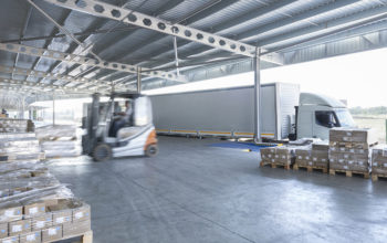 Forklift truck loading lorry